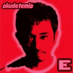 E. - Tamio Okuda